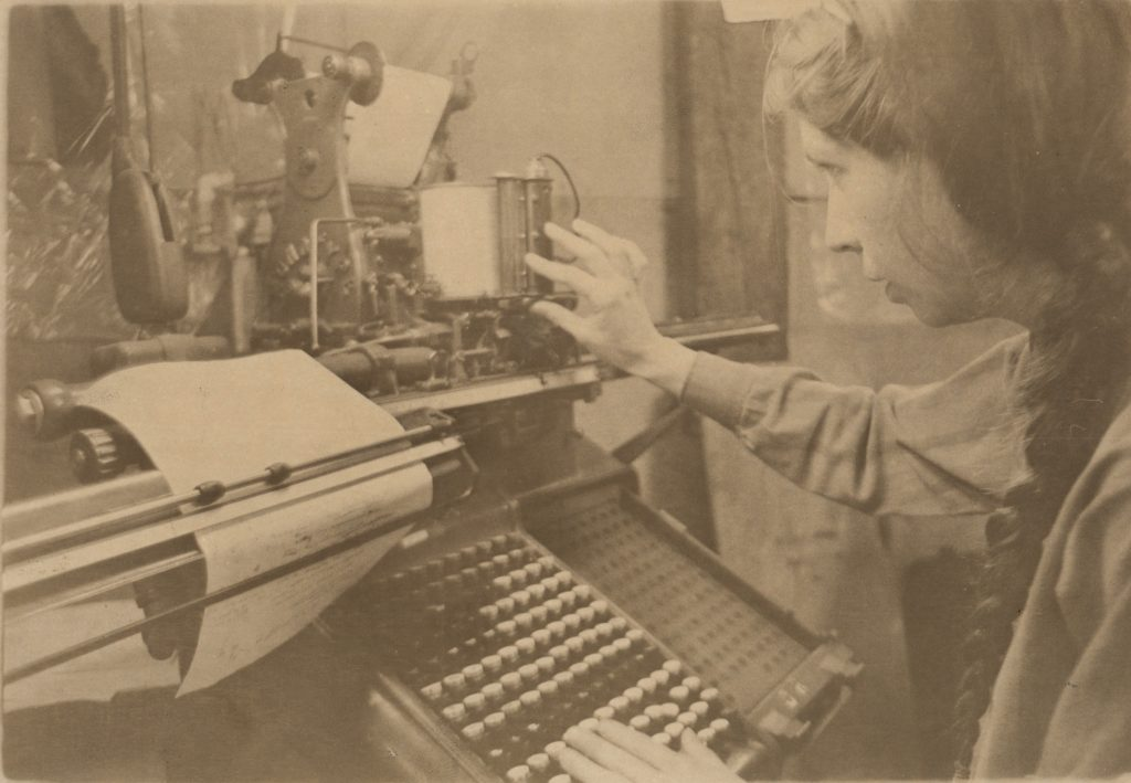 At the Golgonooza Letter Foundry & Press with Julia Ferrari at the monotype keyboard, keyboarding a manuscript c 1983-4