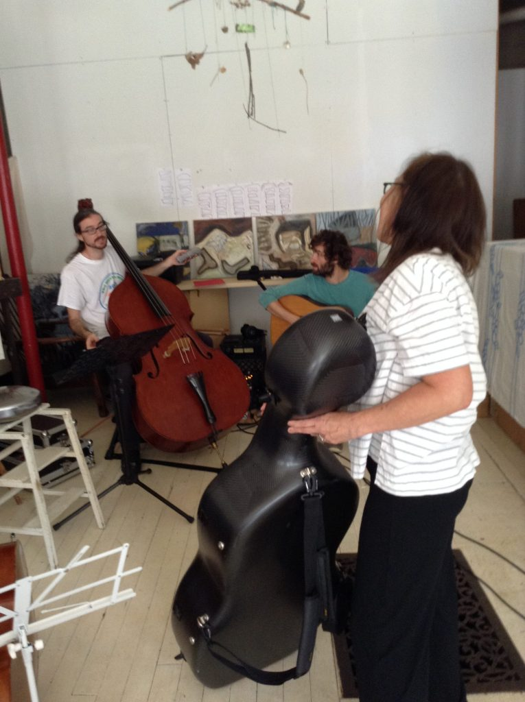 Gahlord Dewald, Nate Schaffer and Janine Wong setting up in Julia's studio